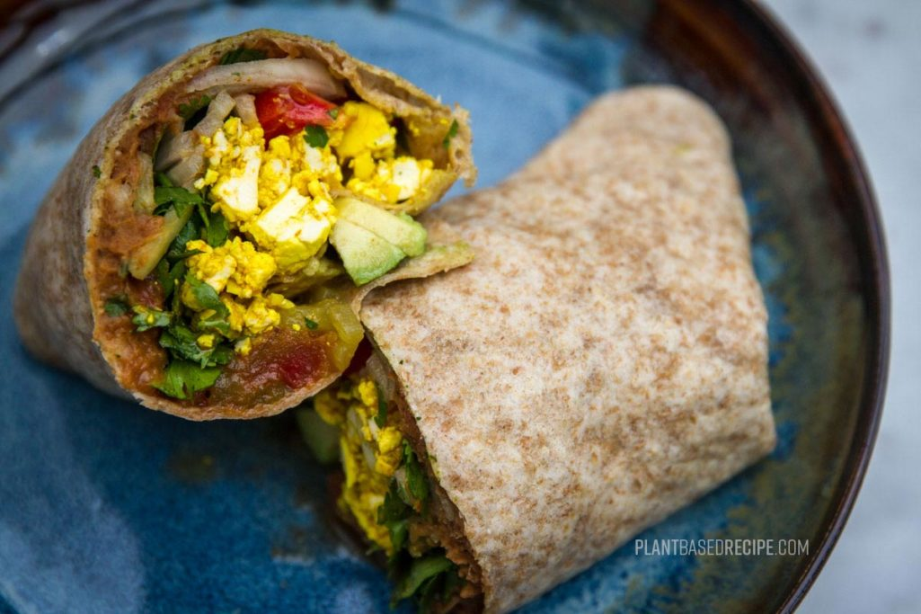 Vegan breakfast burrito on a plate.