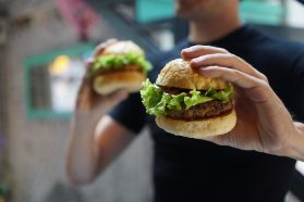 vegan burger being held